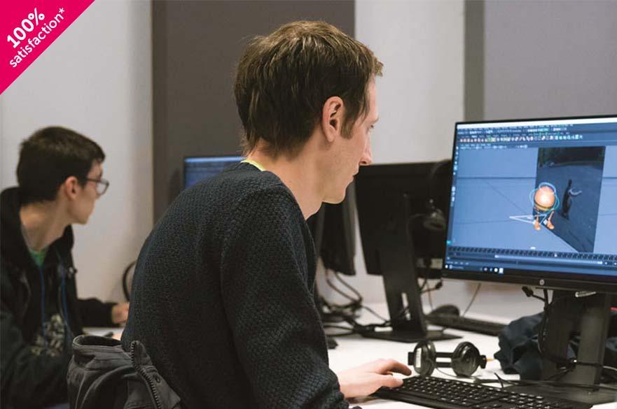 students working in computer studio