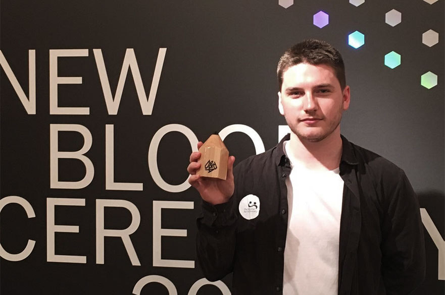 Jay Culley holding his wooden pencil award