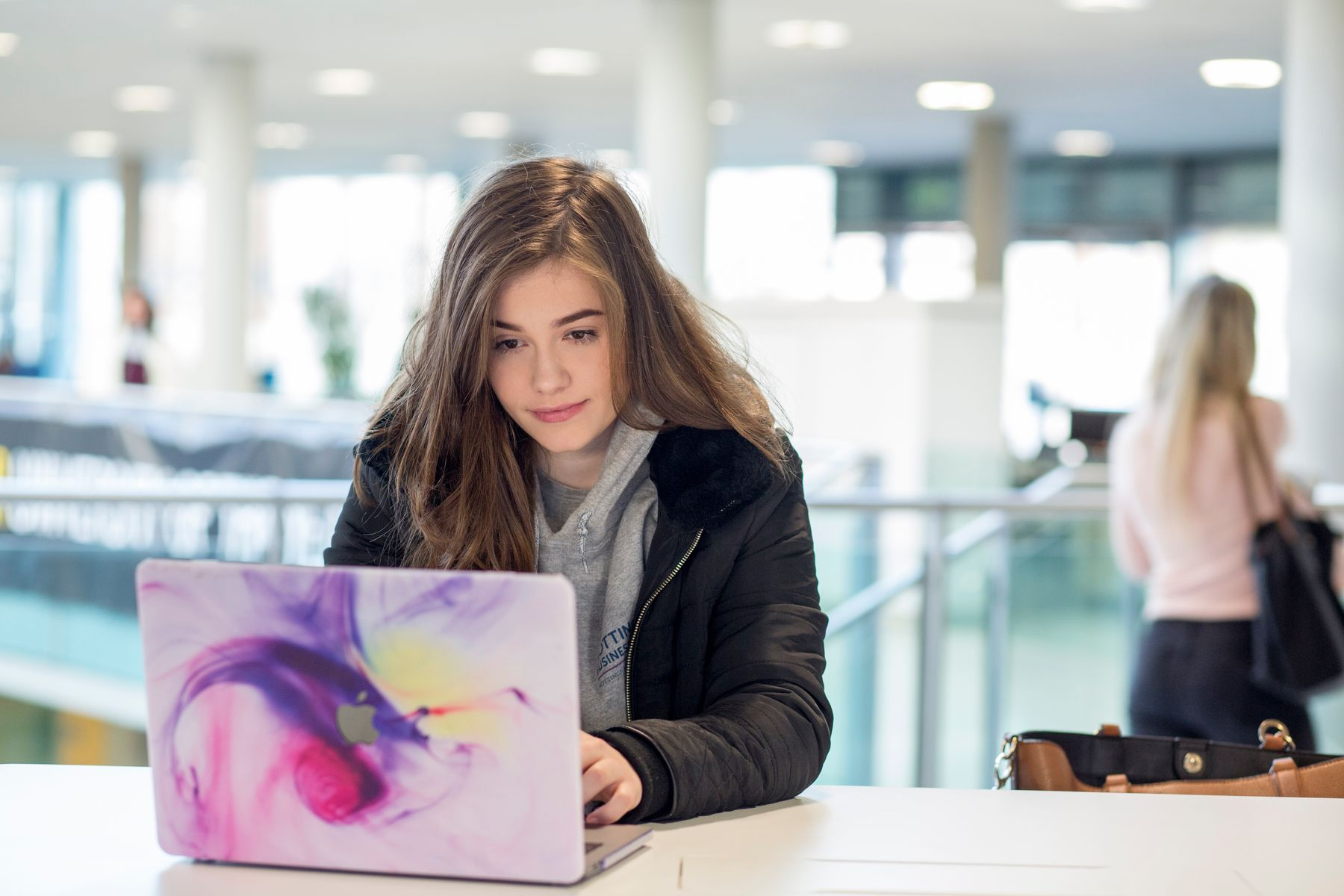 Female student at laptop