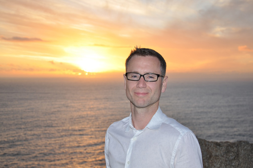 Researcher stood in front of sunset