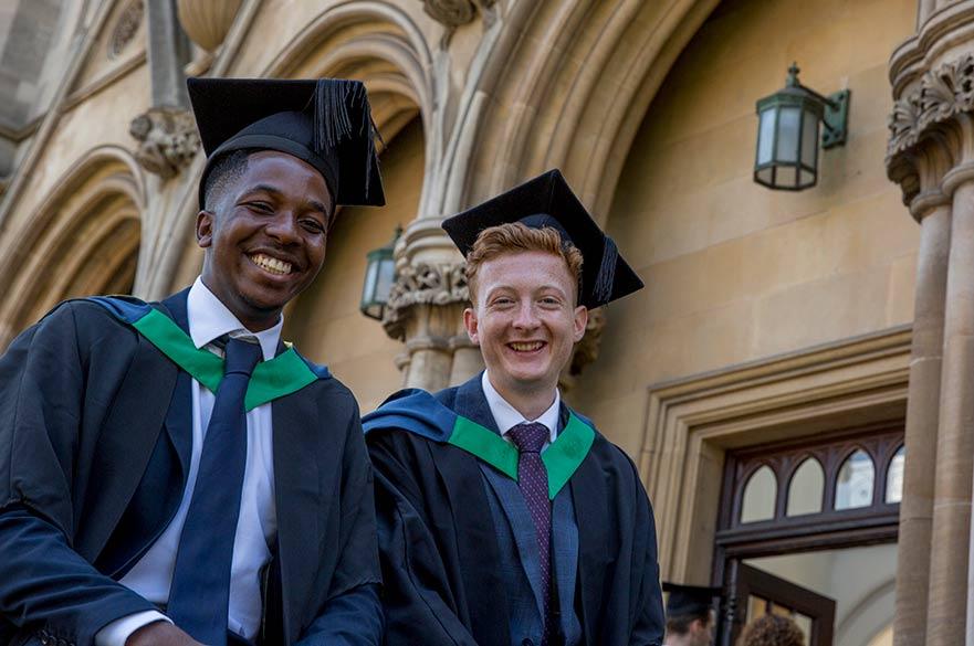 Two Graduands smiling at camera