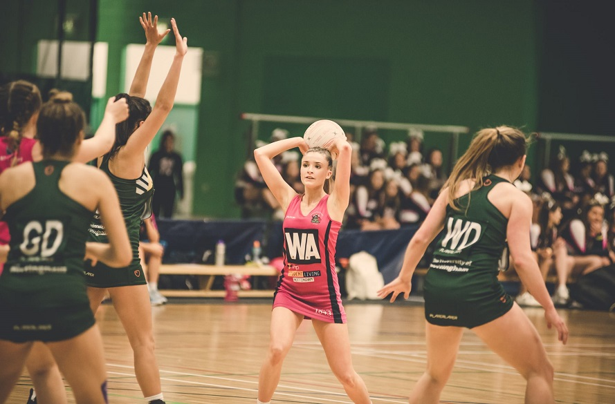 NTU Netball player with the ball in hand