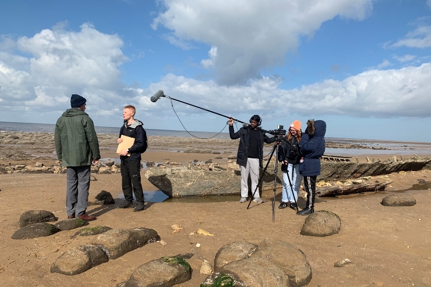 students filming on location