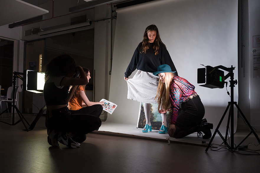 Students working on a project in Fashion Communication and Promotion