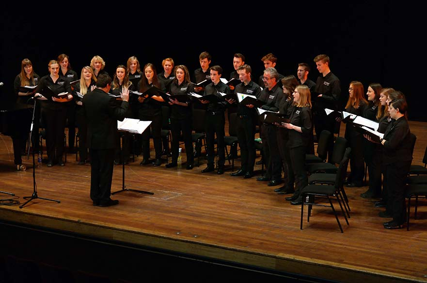Choir performing on stage