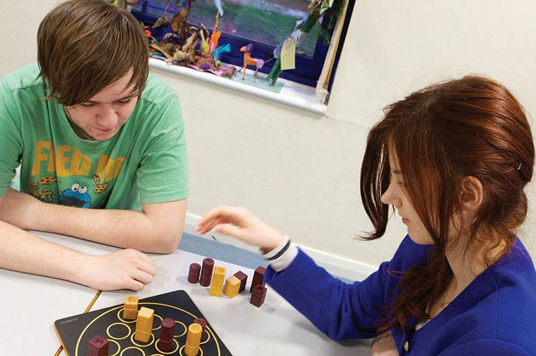 Students using maths puzzles