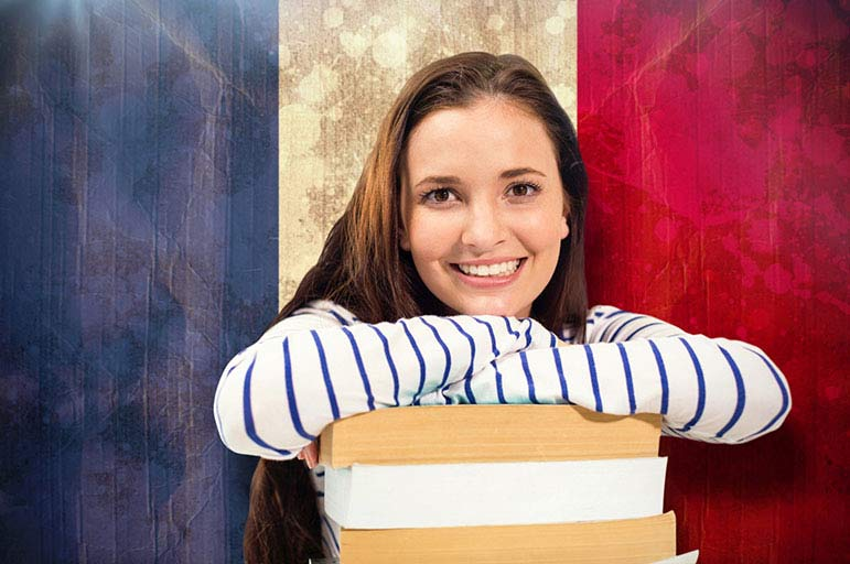 Student in front of French flag