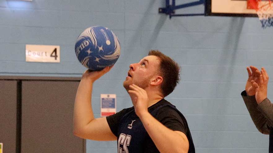 Man playing netball