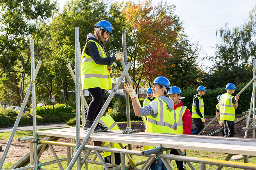 Civil engineering students from Nottingham Trent University working on a bridge building exercise with construction company NMCN.