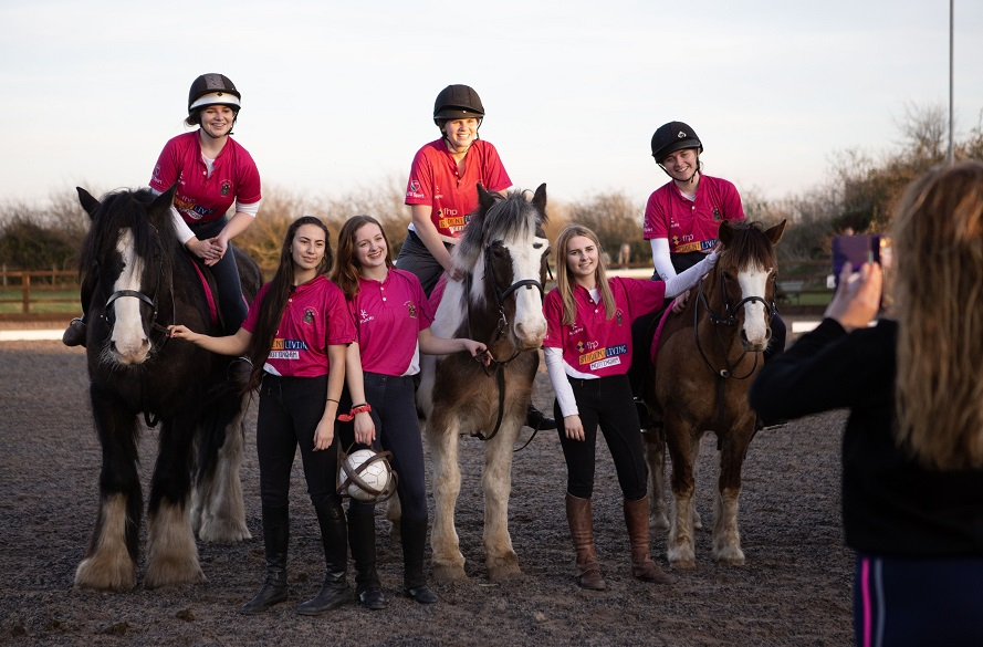 Equestrian team with horses