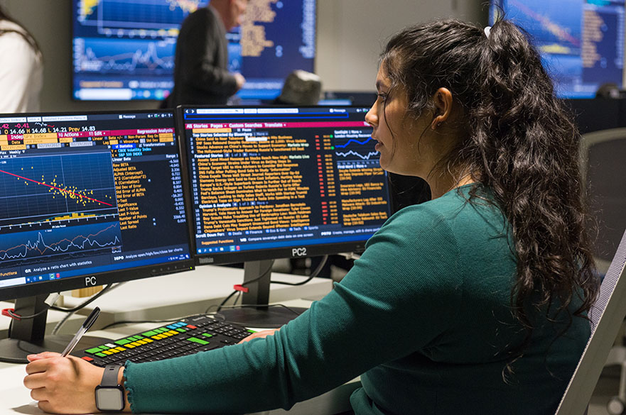 Student working on the Bloomberg terminals in the Nottingham Business School Business Lab on the City Campus at Nottingham Trent University