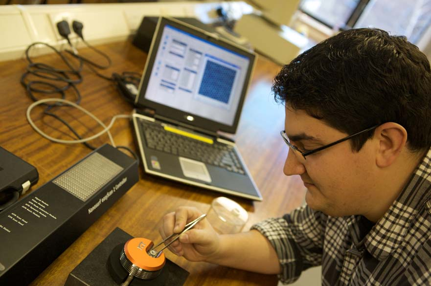 Student testing electrical equipment with laptop