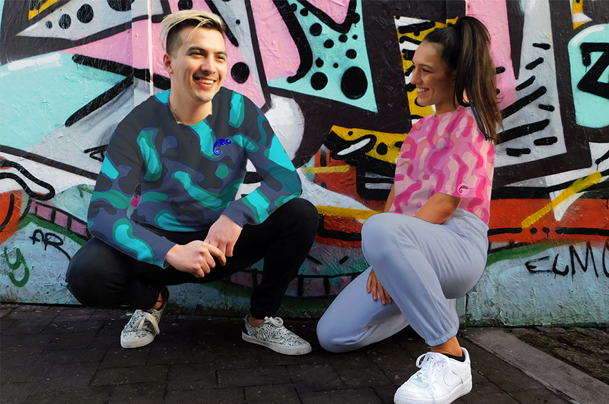 A man and woman crouched down wearing activewear and t-shirts designed by Textile Design students