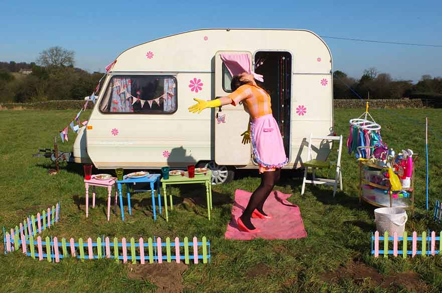 Woman standing outside caravan