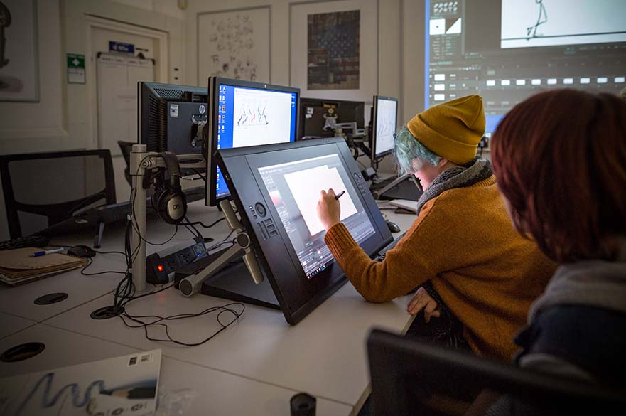 A female student working on a touch drawing screen