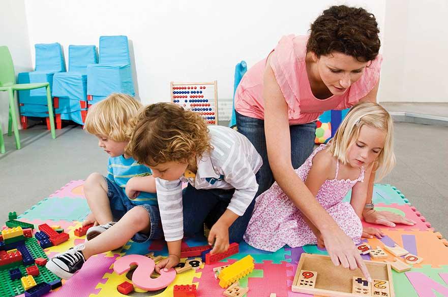 Children playing on mat