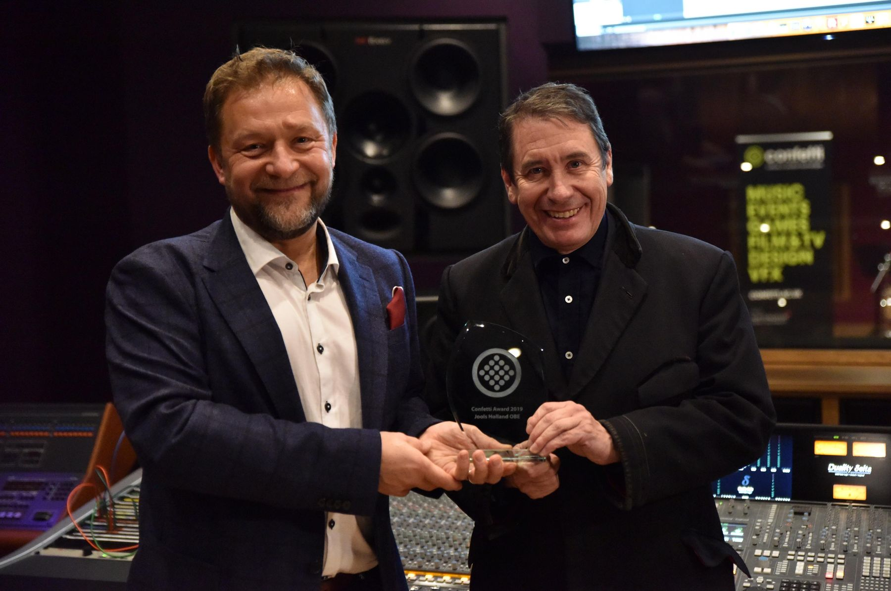Craig Chettle and Jools Holland with award