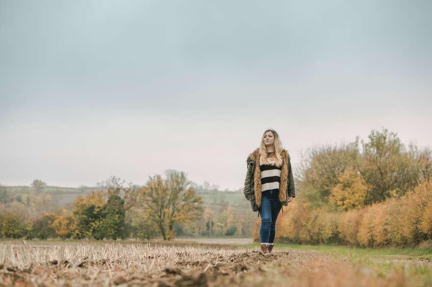 Student walking in a field