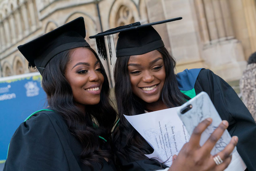 Two NTU students taking a selfie outside the Arkwright Building.