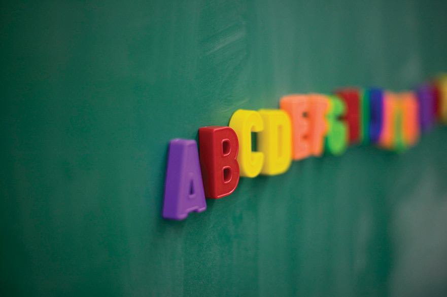 ABC magnetic letters on blackboard
