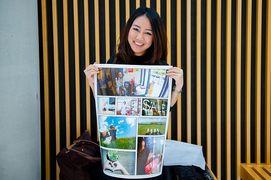 Student holding poster