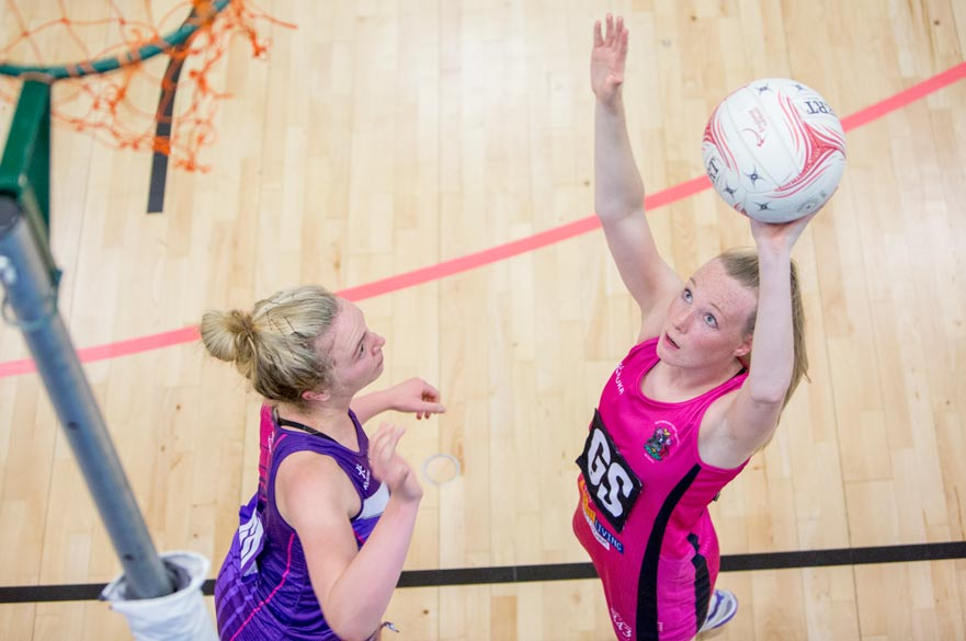 An NTU player shooting a goal against Loughborough University