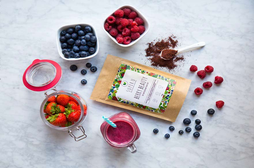 Super U berry blend surrounded with fresh fruit