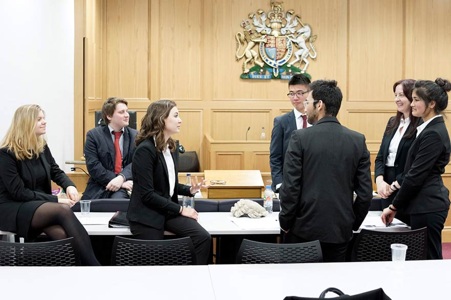 Students talking in courtroom