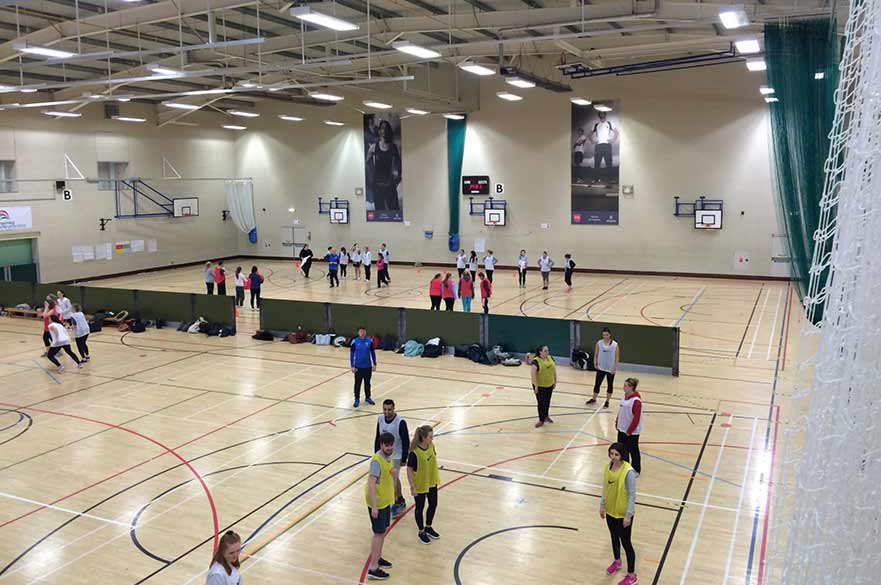 Students in sports hall taking part in FA session