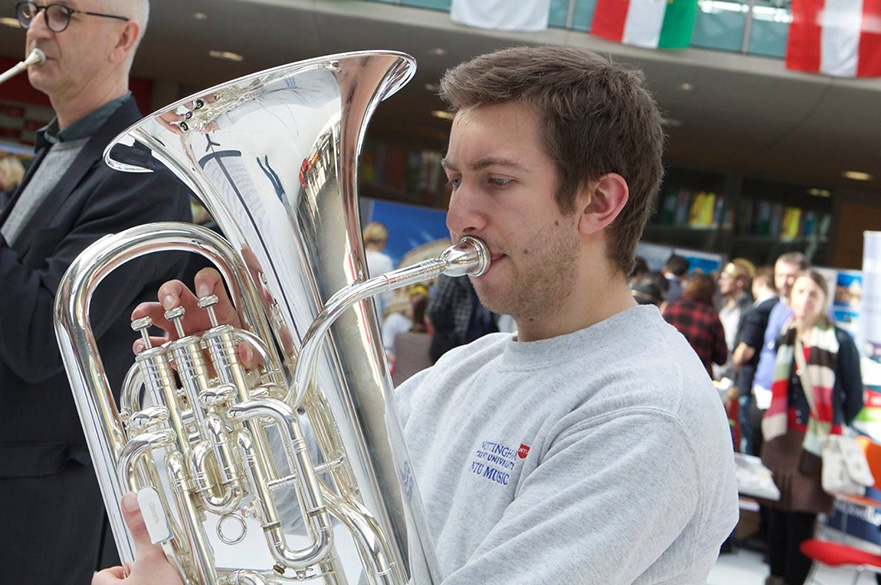 Student playing brass instrument