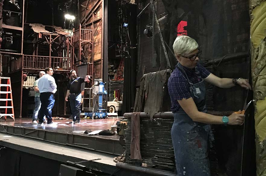 Totie Driver working on the Miss Saigon set