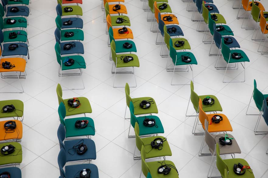 Empty chairs at a conference