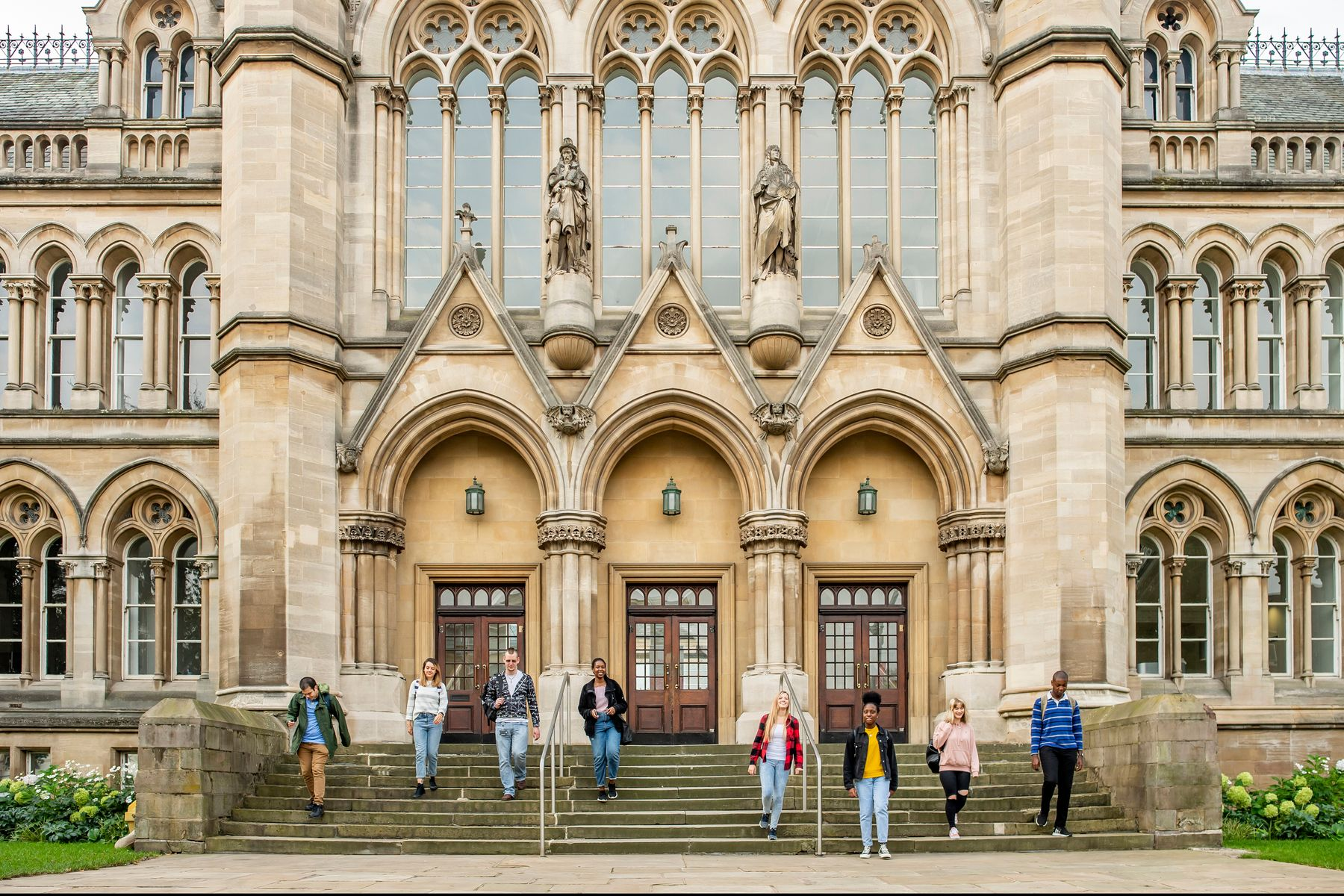 A wide shot of the Arkwright building showing several students walking down the steps