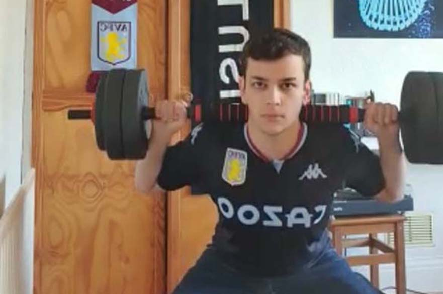 Student lifting weights to raise money for good causes