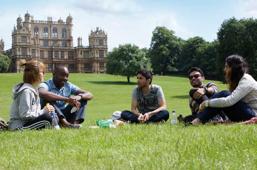 Students sitting in Wollaton Park