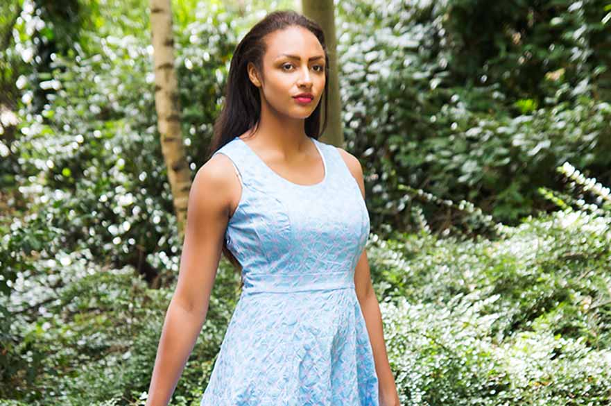model wearing light blue summer dress