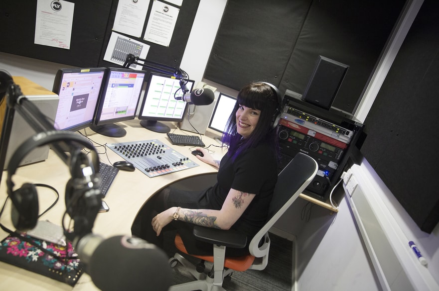 Jen Thomas, one of the award winners, at her radio desk