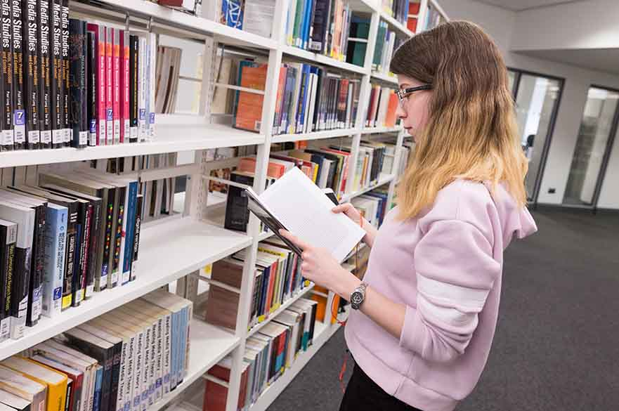 Student looking at book
