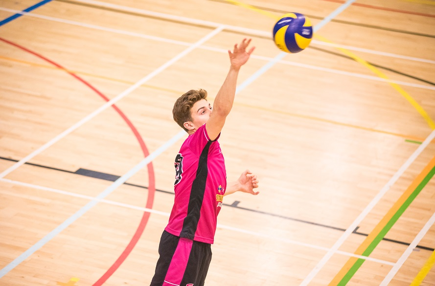 male Volleyball player hitting ball