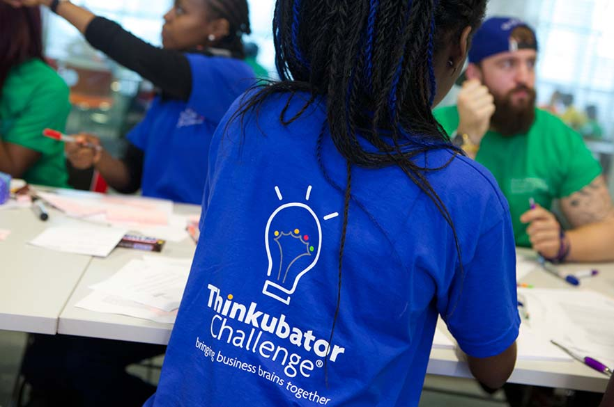 people wearing Thinkubator challenge t-shirts