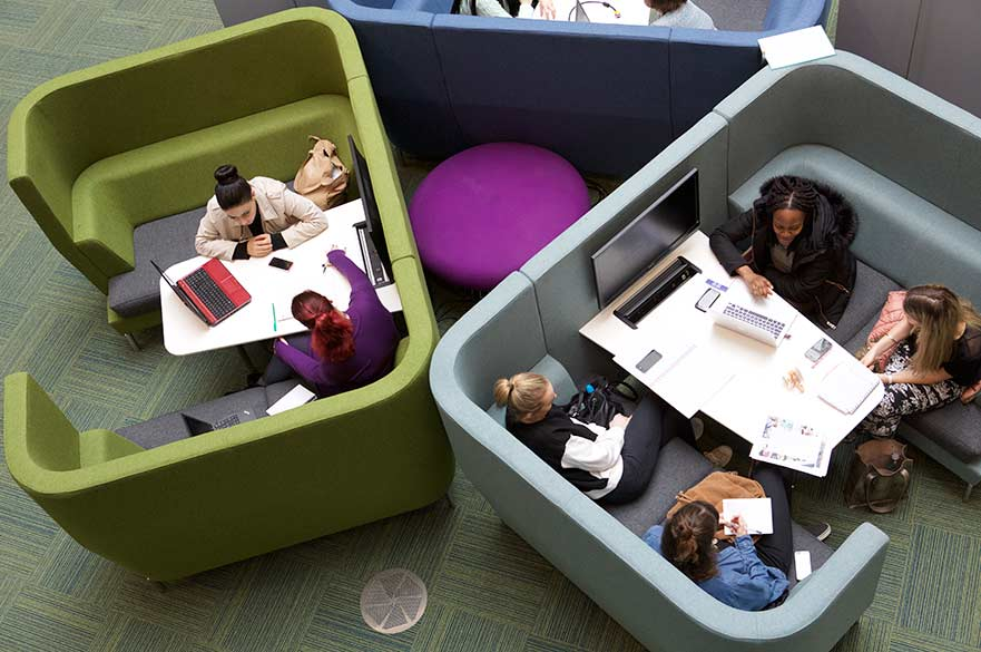 Birds eye view of students working at a table