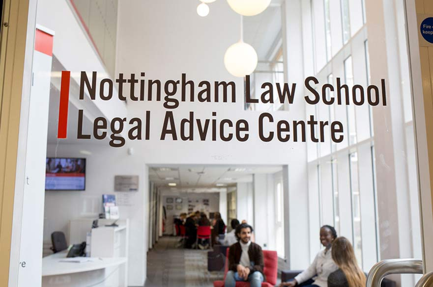 view of the Legal Advice Centre through glass door with the centre name printed on it