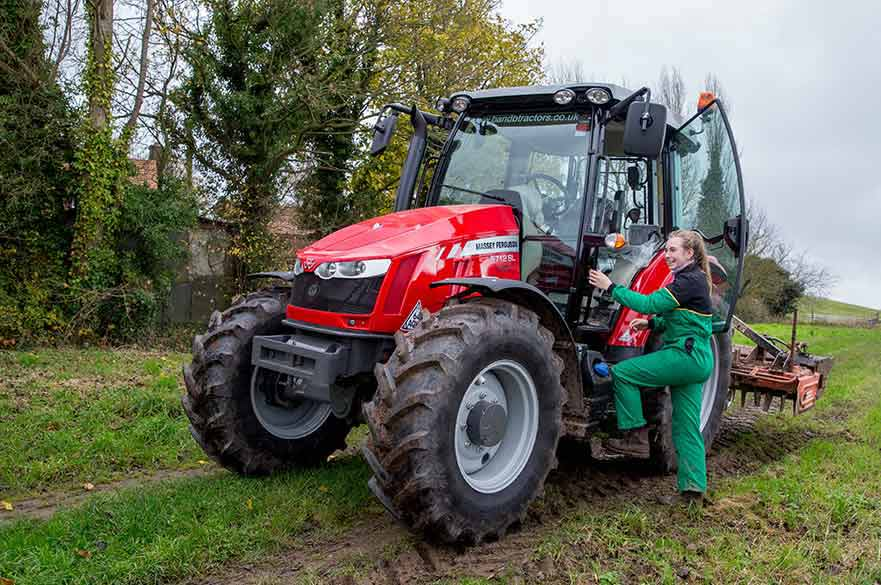 Student using a tractor