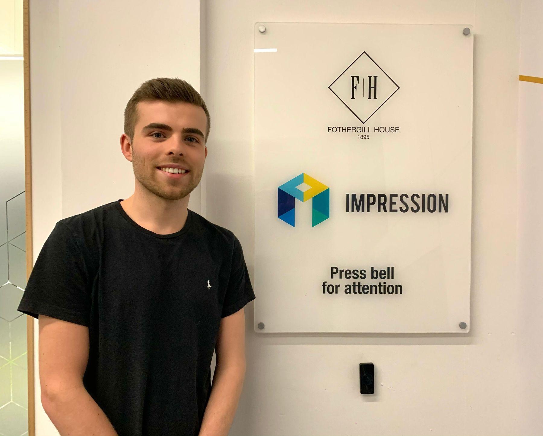 Reuben Hewitt with the Impression Digital sign