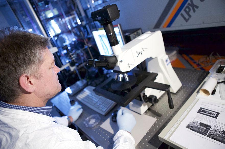 Man in lab using excimer laser