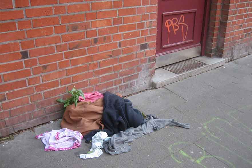 pile of clothes on floor near door