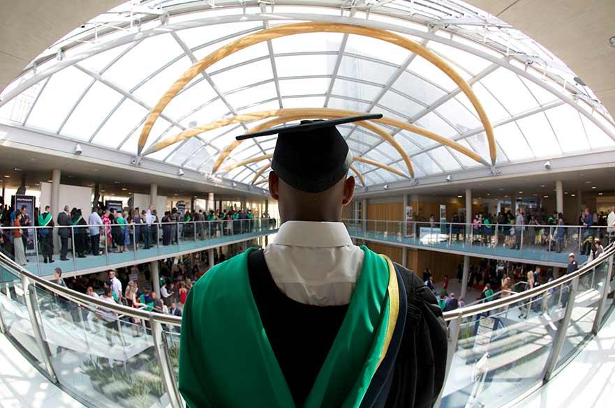 Graduate overlooking NTU atrium