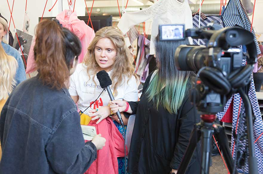Students being interviewed on the NTU stand at Graduate Fashion Week
