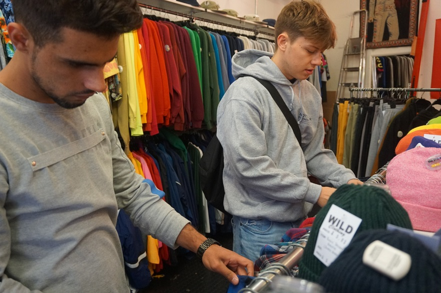 Males students in a clothes shop