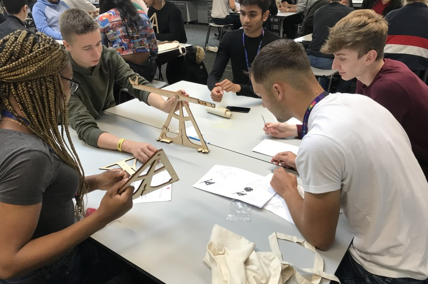 Students working on mechanical engineering project